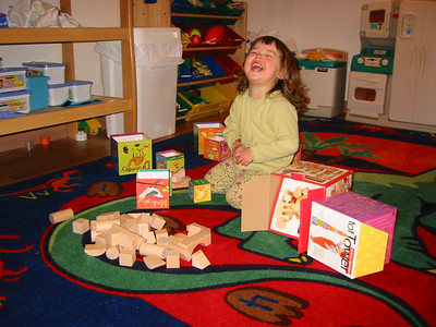 Rachel shows us some great unbridled laughter while playing with some birthday gifts.