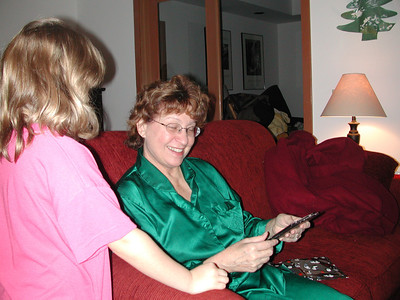 Grandma opens up DVDs of family home movies.