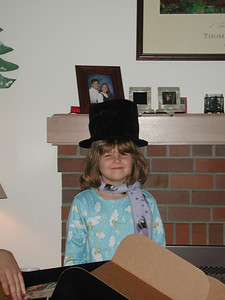 Kayla dons her new magician's hat.