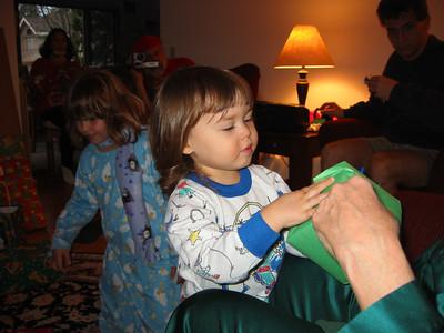 Rachel helps Grandma open a gift.
