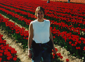 Kris in a field of Skagit Valley tulips, during our first spring in Washington.  Mount Vernon WA April 1995