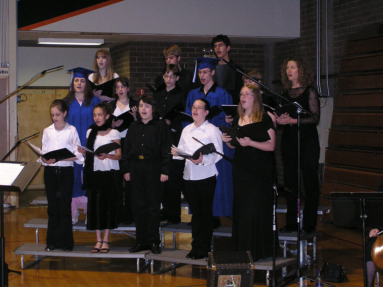 Kevin sang in the choir, too.  He is on the 2nd row, 4th from left.  Mary also sang in the home school choir.  She is standing on his left and not well seen.