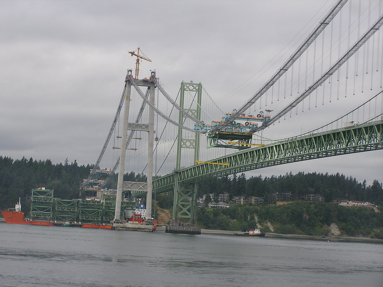 Bridge sections arrive by boat and are apparently lifted into place.  Interesting process ...