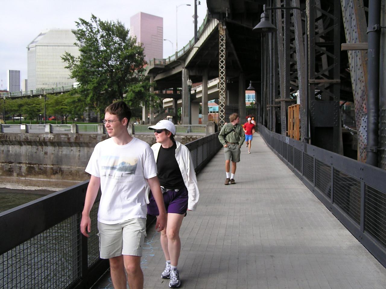 Walking on the walkway on the Steel Bridge looking west towards downtown Portland.