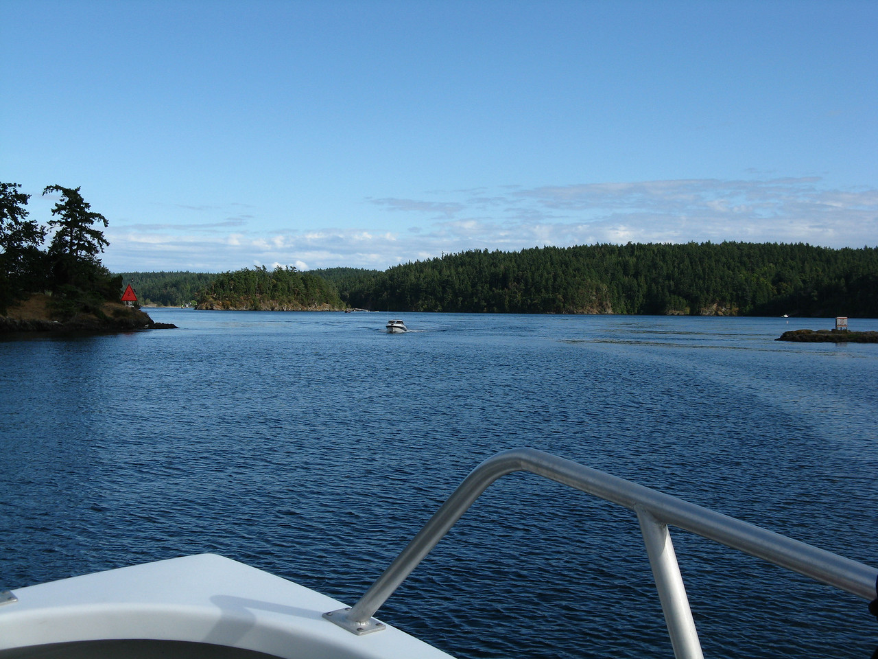 Narrow passage way east of Deer Harbor.  Orcas on the left and Crane island tip on very right side, Shaw Island straight ahead.