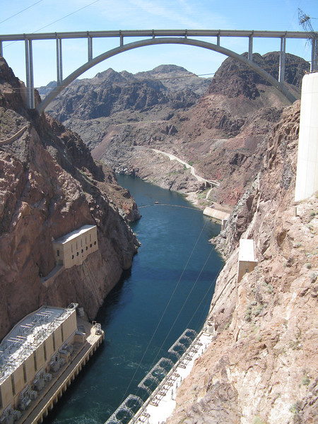 The new bridge crossing the Colorado River lies just downstream from Hoover Dam.  The buildings along the river contain generators that make electricity.