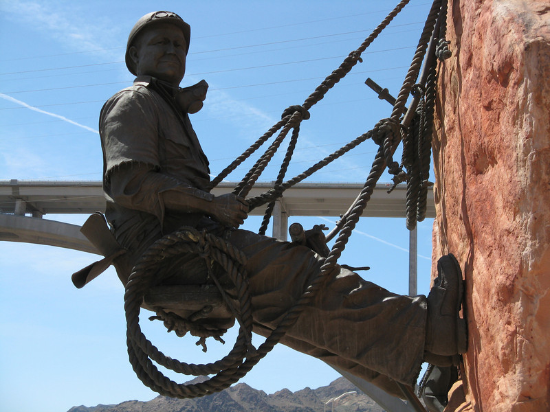 """This is a bronze statue of a """"high scaler"""", which is what the men were called who repelled down the vertical rock face of the canyon in order to remove loose rock where the dam would join the canyon walls."""