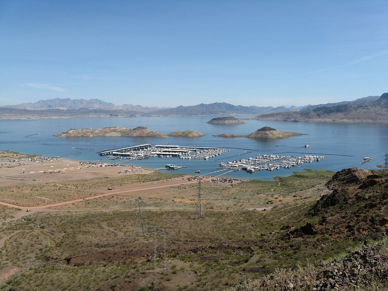 This marina on Lake Mead lies just upstream from Hoover Dam.  The water level is very low.  The gray band on the ground above the water line of the lake is coverd by water when the water level is up to normal.