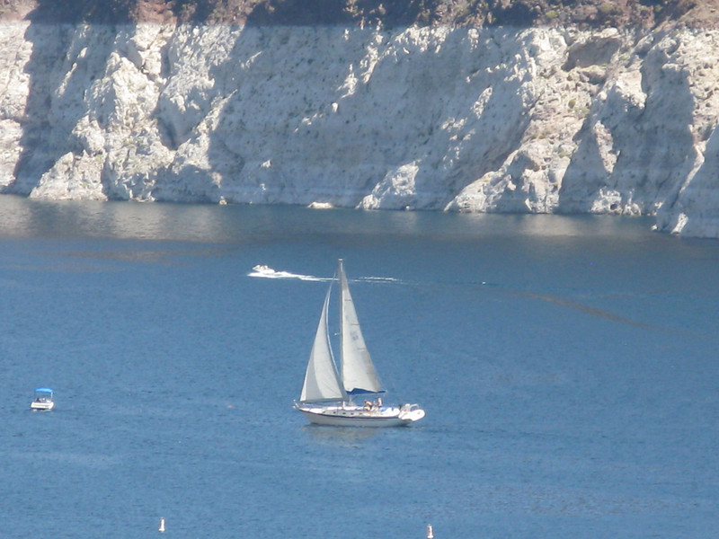 Another sailboat on a beat in the canyon above Hoover Dam.  Note that the top of the gray band that represents the high water mark is 100 feet or more above the actual level of the lake in April, 2011.