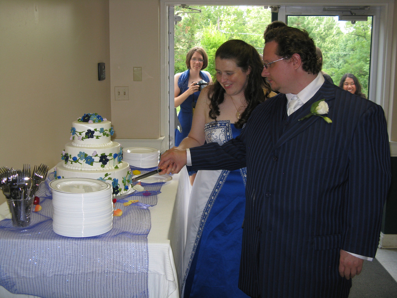 Cutting the cake.