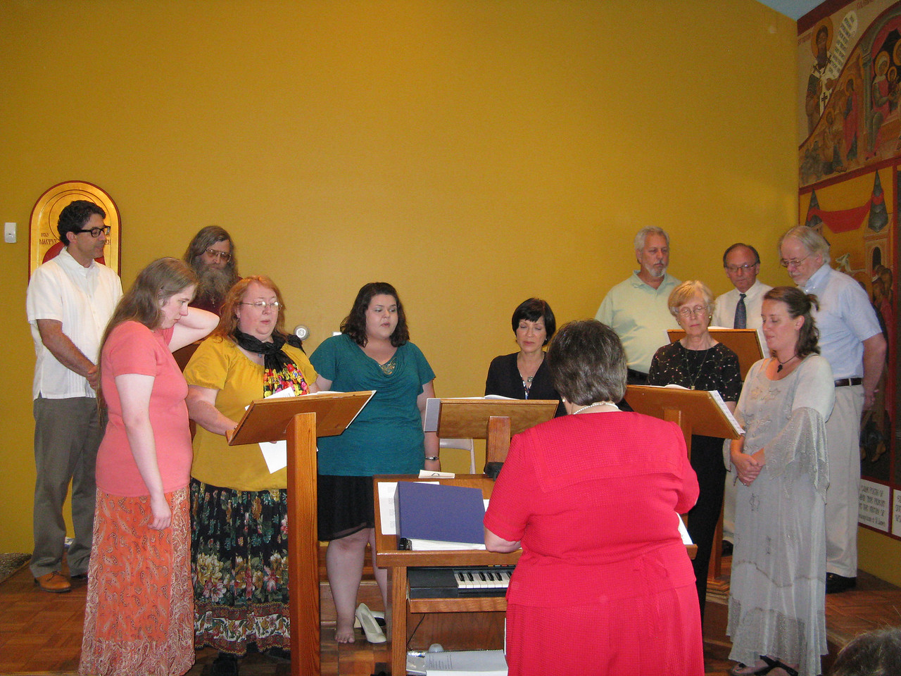 The choir sang in the back of the church.