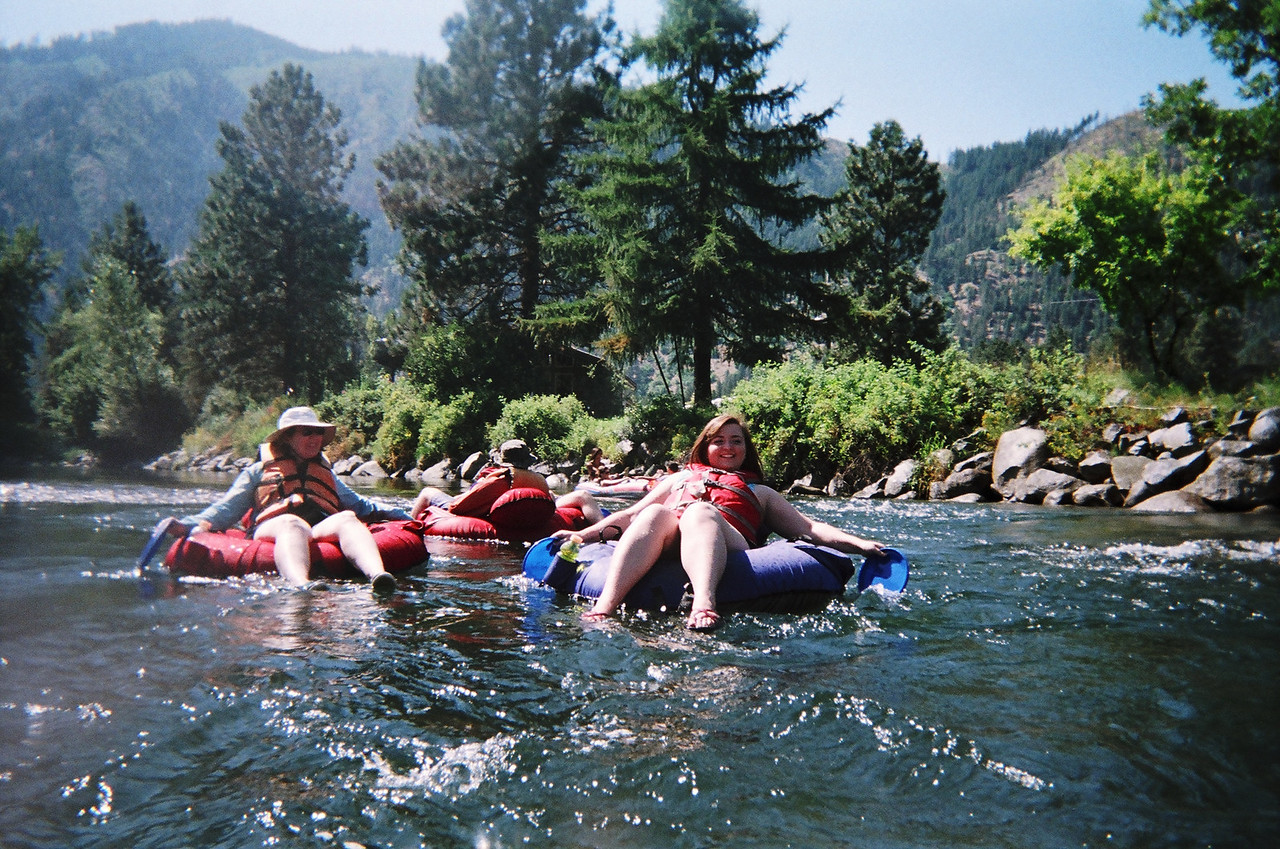 We went from rapids to pool all the way down the Icicle River.  This is a little rapids and Becca is using her frisbees to try to control where the the current takes her.  Mary is on the left and Nathan is in the background.