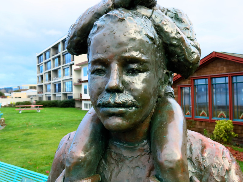 A close up of the face of the sculpture.