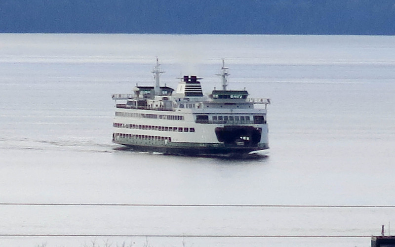 The Edmonds-Kingston ferry is heading into the Edmonds ferry dock.  This view is from the library in Edmonds.