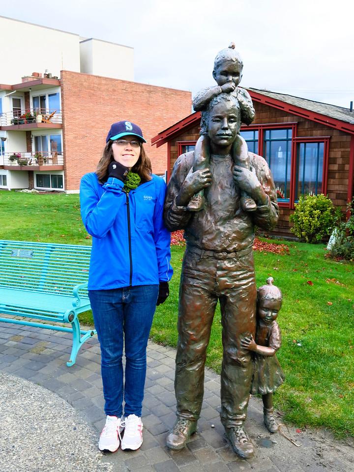 Ann posing beside another sculpture near the beach in Edmonds.
