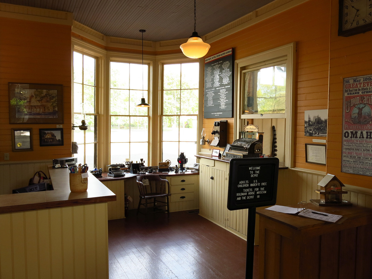 The station agent's office inside the depot.  The cash register sits on the inside of the ticket window.