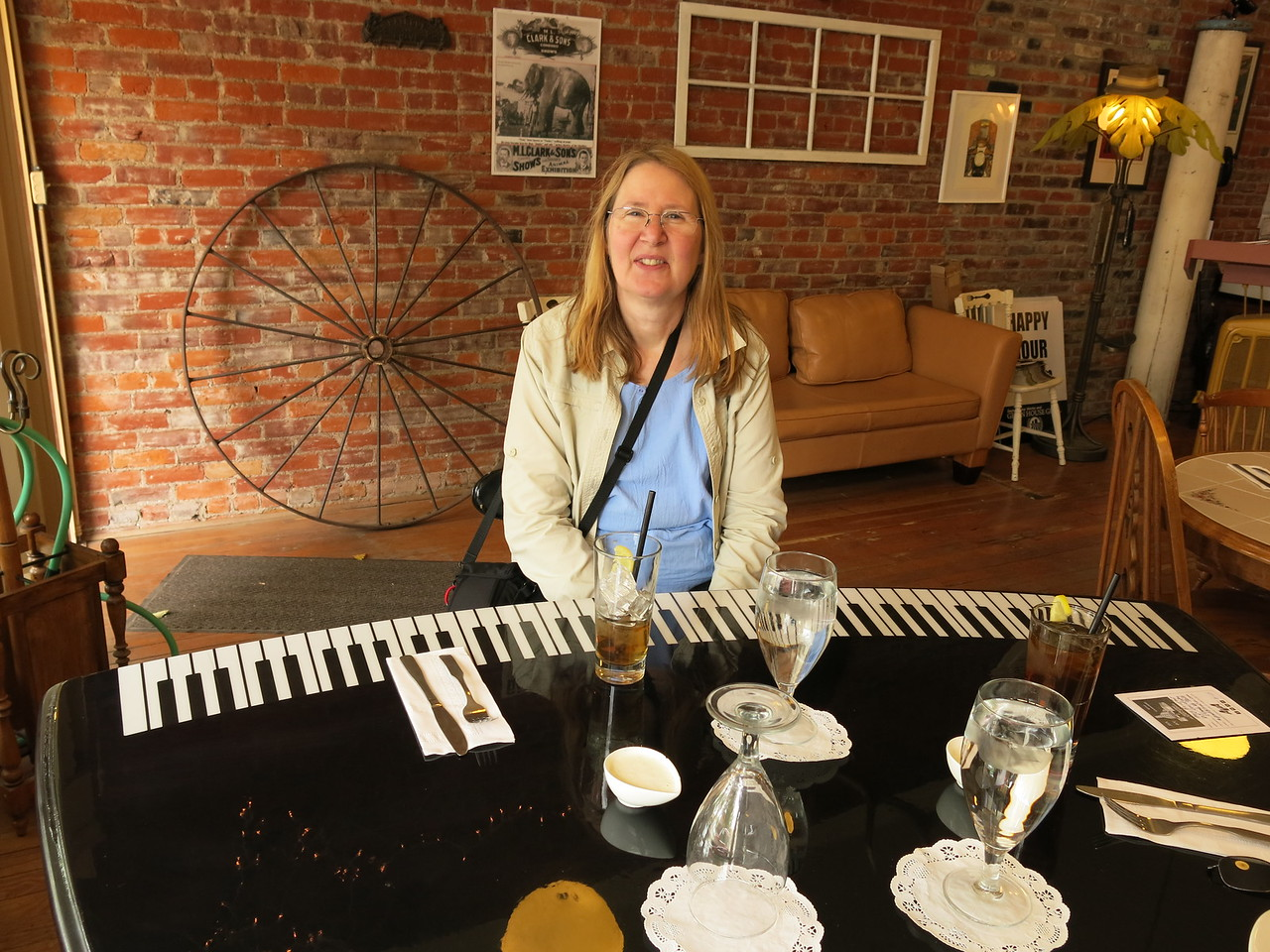 We had a good lunch at the Grain House Grill on Main Street.  Mary is sitting at the piano table.