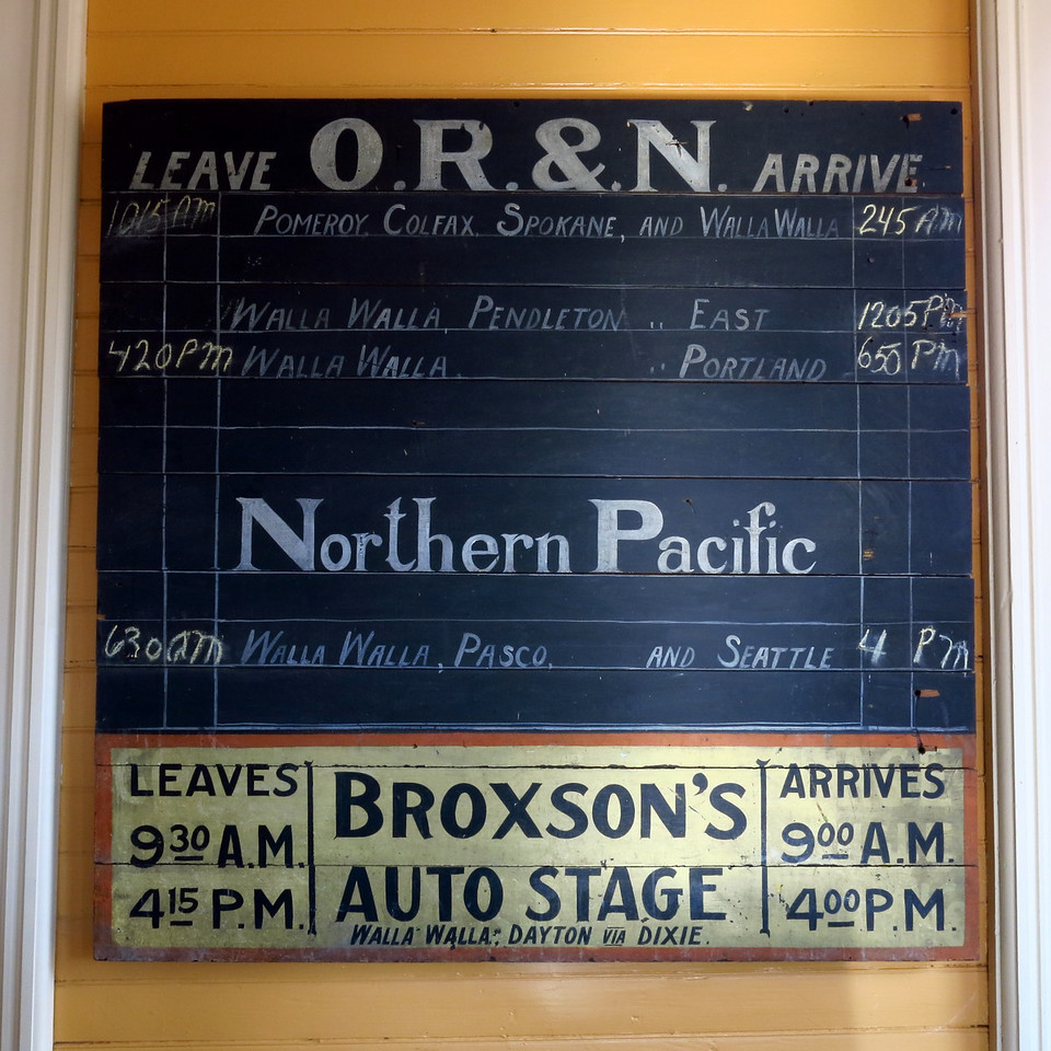 The train schedule on the inside of the depot.
