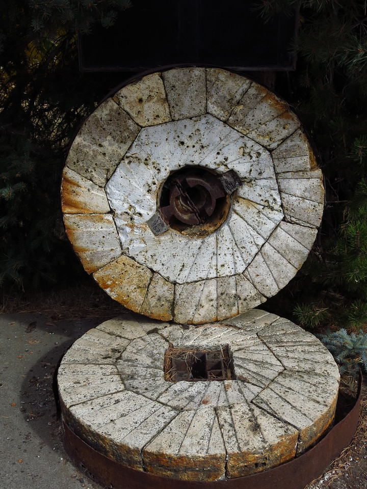 This is a stone grinding wheel for grain such as wheat.  It was originally used in a grist mill in Dayton in the 1800s.  It sits along the river trail in Dayton.
