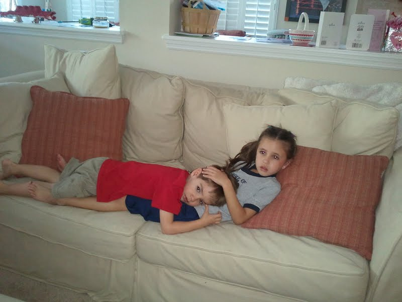 Snuggling on the couch after school.  Melts my heart.