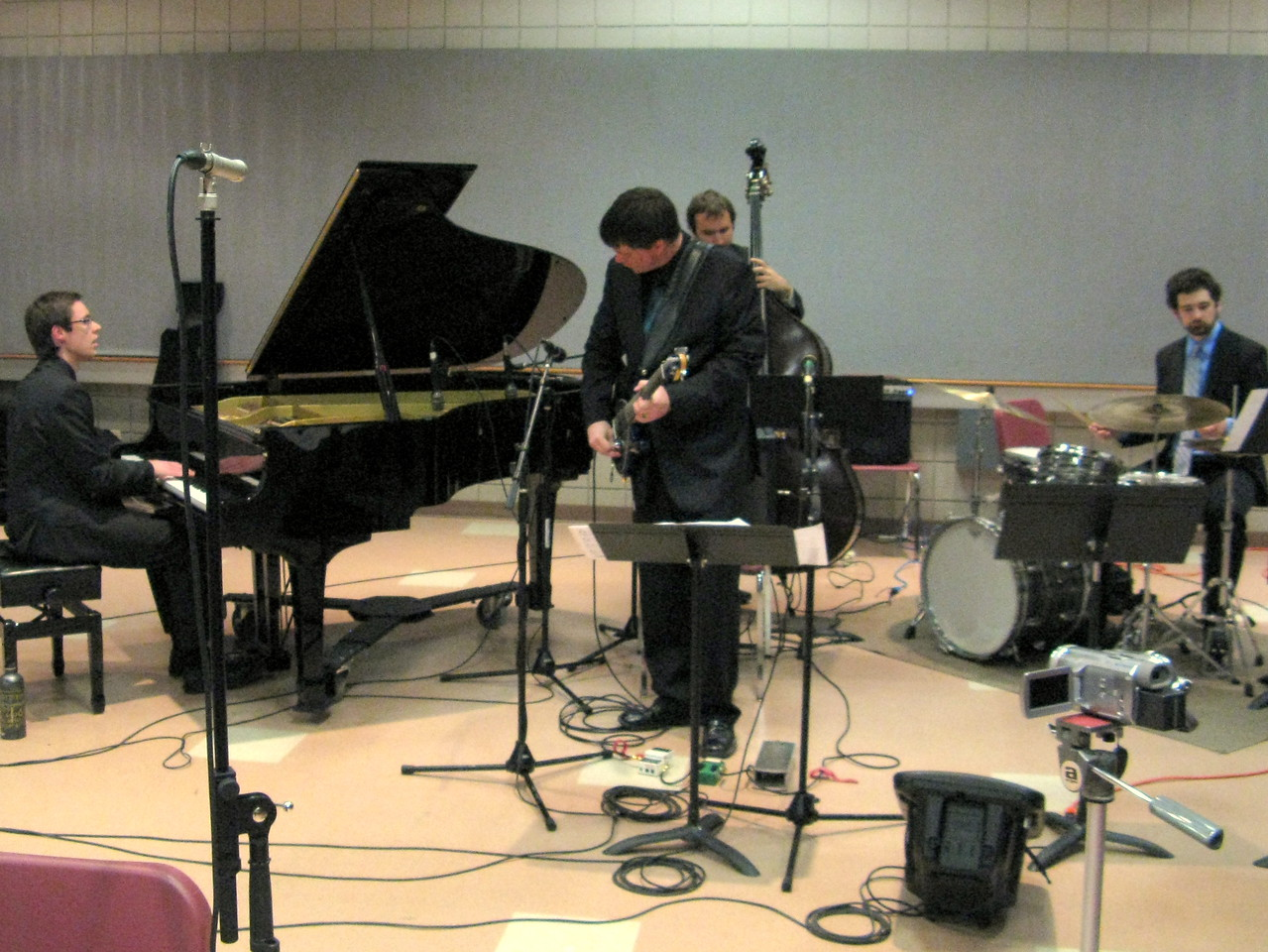 The quartet of piano, guitar, bass and drums.