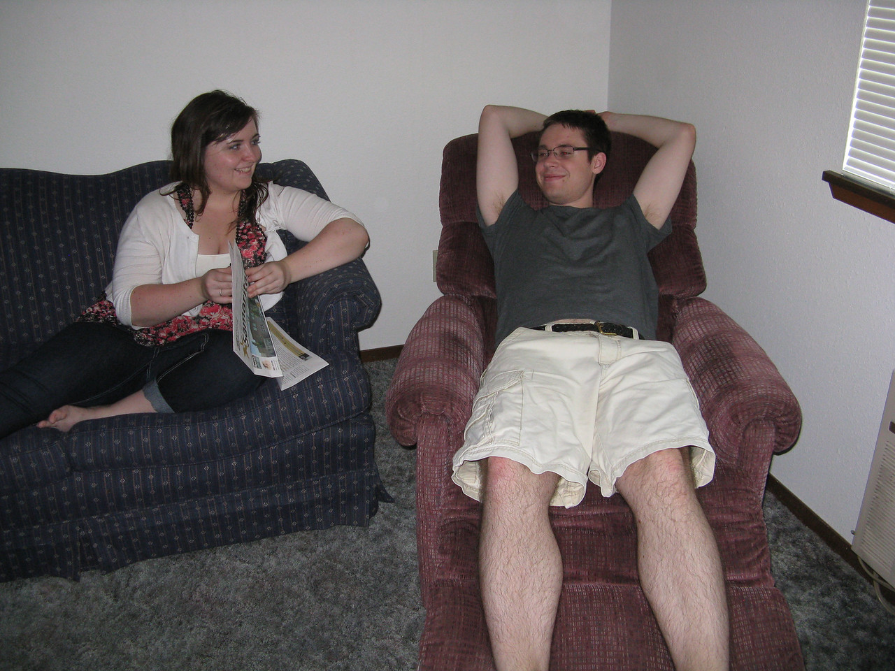 Kevin and Becca relaxing in the living room.  Kevin found the used recliner chair, too.