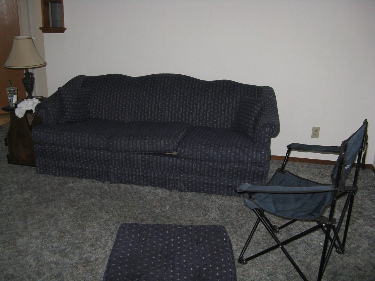 On the day that we arrived, Kevin found this sofa on Craig's list.  Incredibly, there was a nearly matching ottoman available as well.  We picked up the stuff in the van.