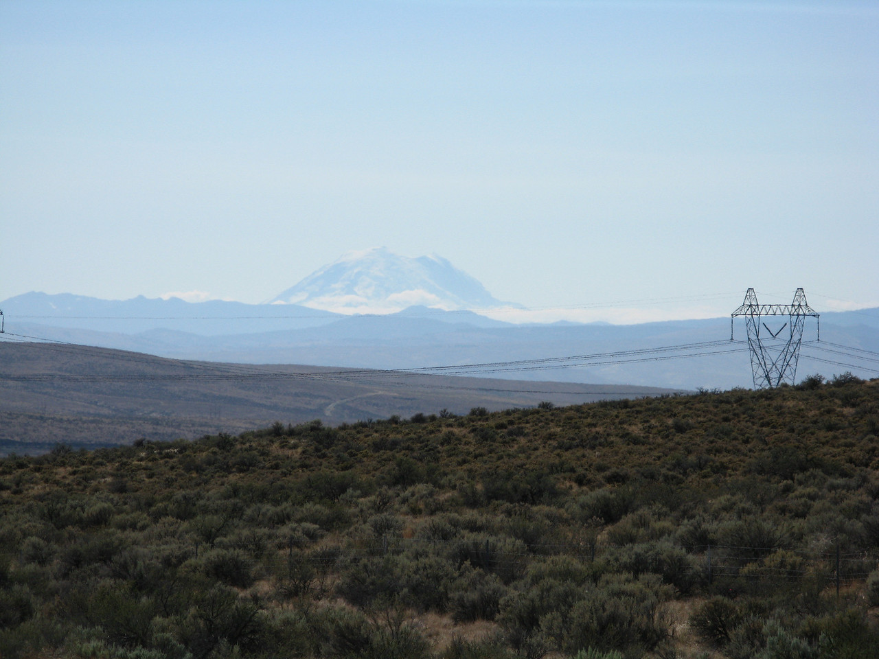 Looking west from the rest area, away from the wind farm to the north, we can see the east flank of Mount Rainer, which is at least 100 miles away.