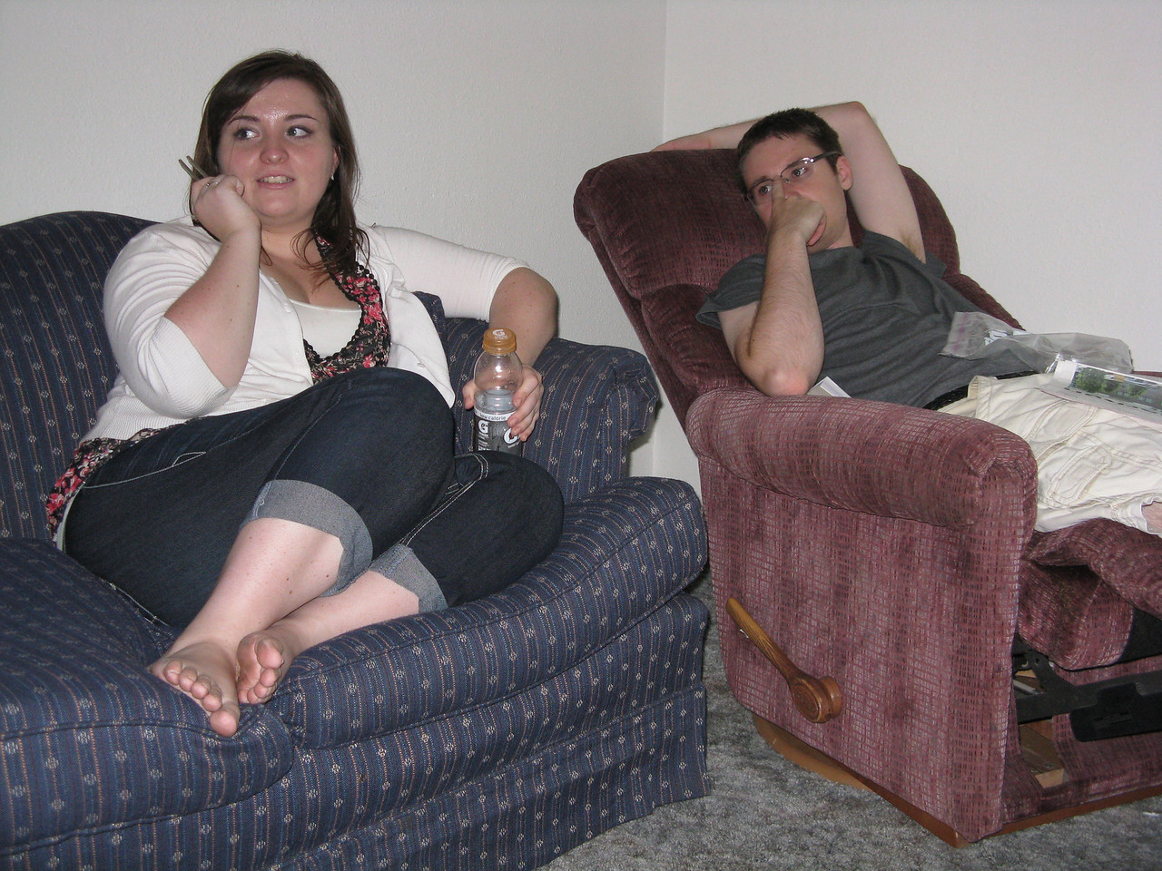 Becca and Kevin relaxing after a good job at furnishing Kevin's apartment.