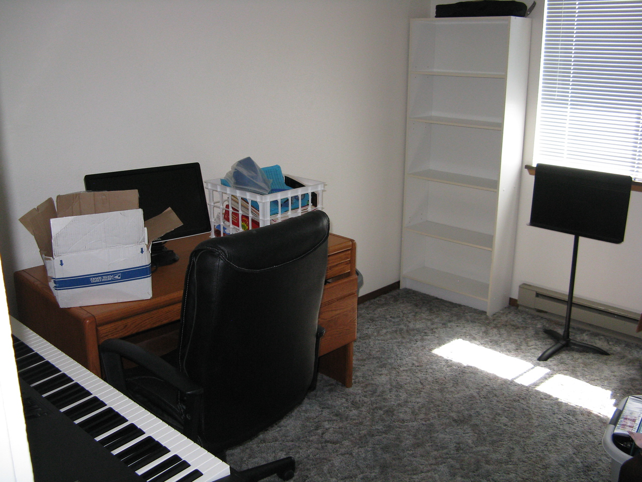 The second bedroom is Kevin's studio.  He has a desk, bookcase and his keyboard.