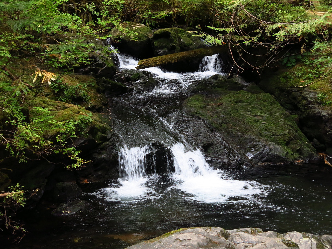 This is a telephoto view of the little water fall upstream from the bridge.