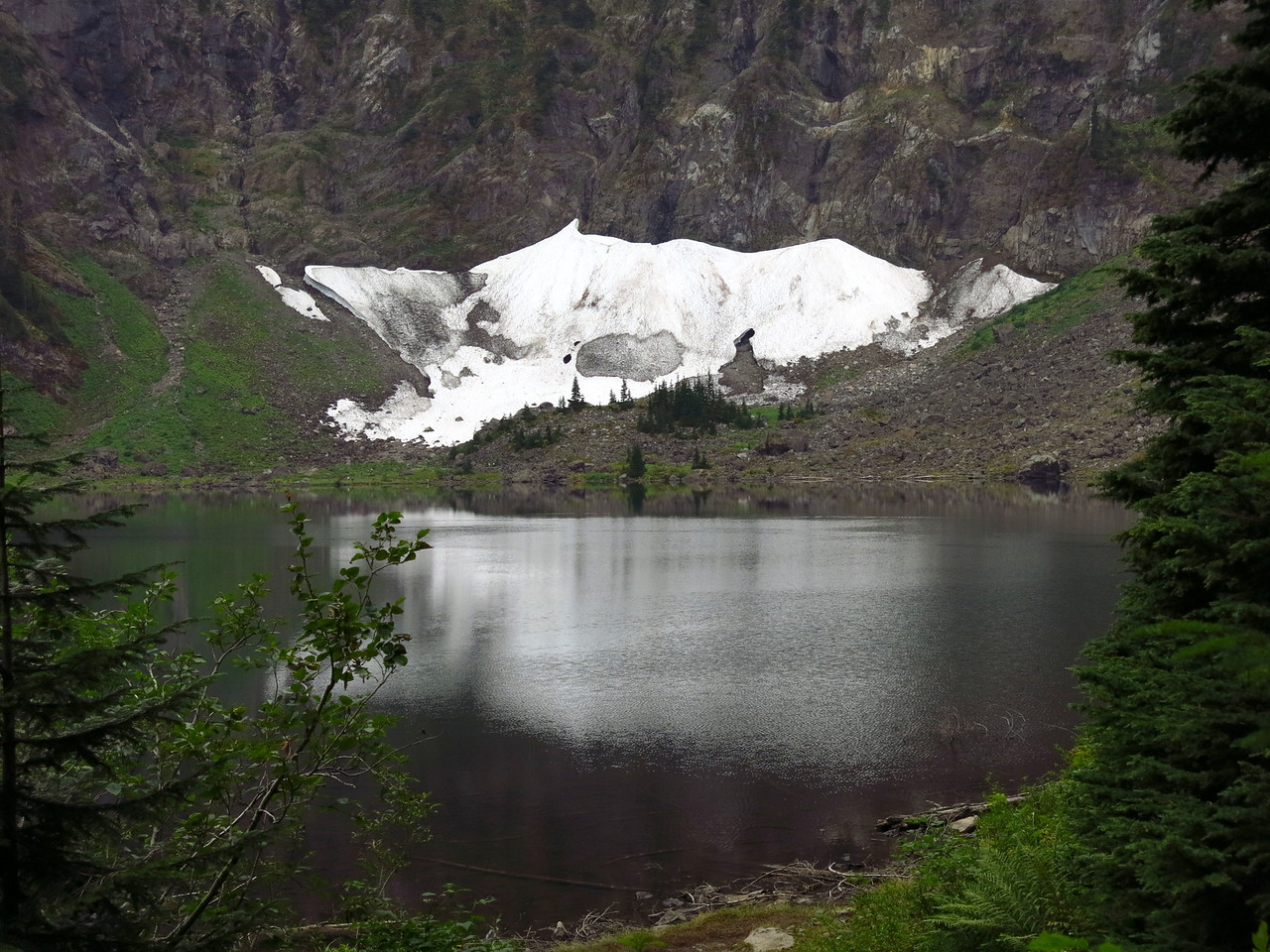 A view of the lake and the snow field from the trail on the west side.
