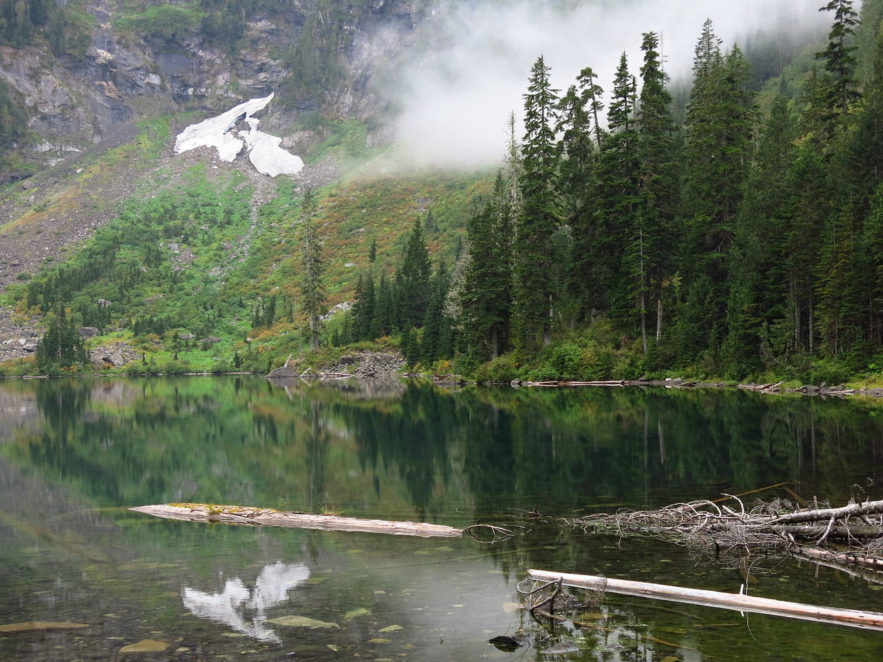 The deep green water, semi-translucent and reflective at the same time, is a fascinating feature of many alpine lakes in the Cascade Mountains.