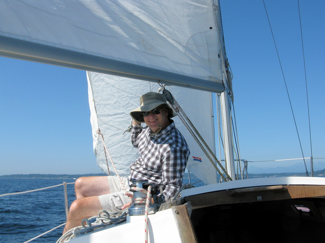 On Saturday, August, 11, we sailed across the sound from Edmonds to Kingston.  Marc is sitting under the sails.