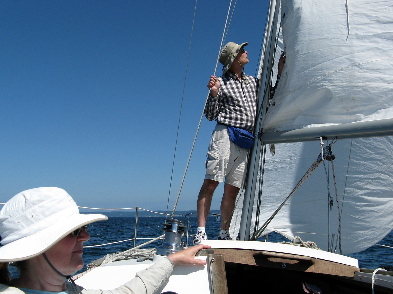 We headed back to Edmonds.   We had 10 to 15 knot winds on return trip.  Marc is standing at the mast and Mary Proudfoot  in the foreground.