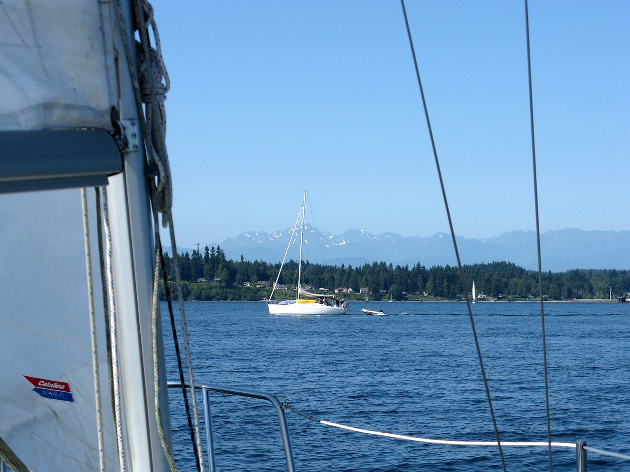 A sailboat crosses our route.