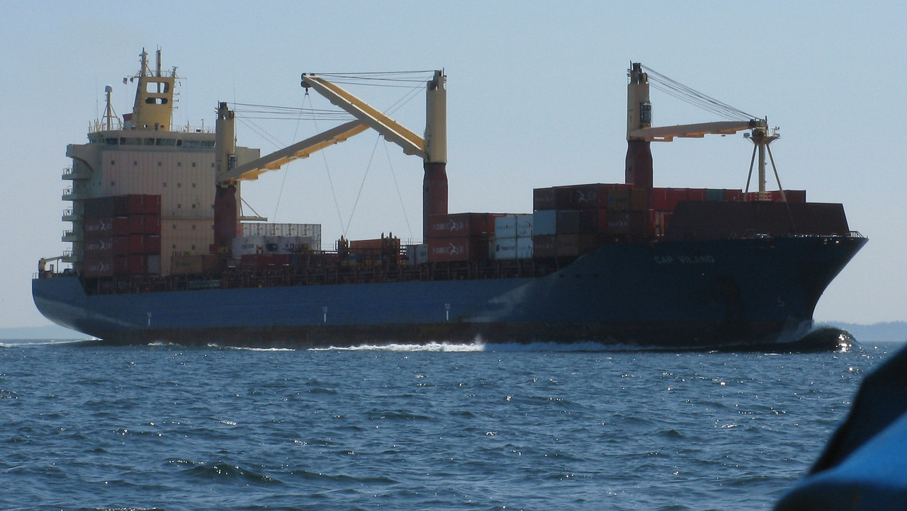 This mostly empty container ship powered behind us as we sailed east.