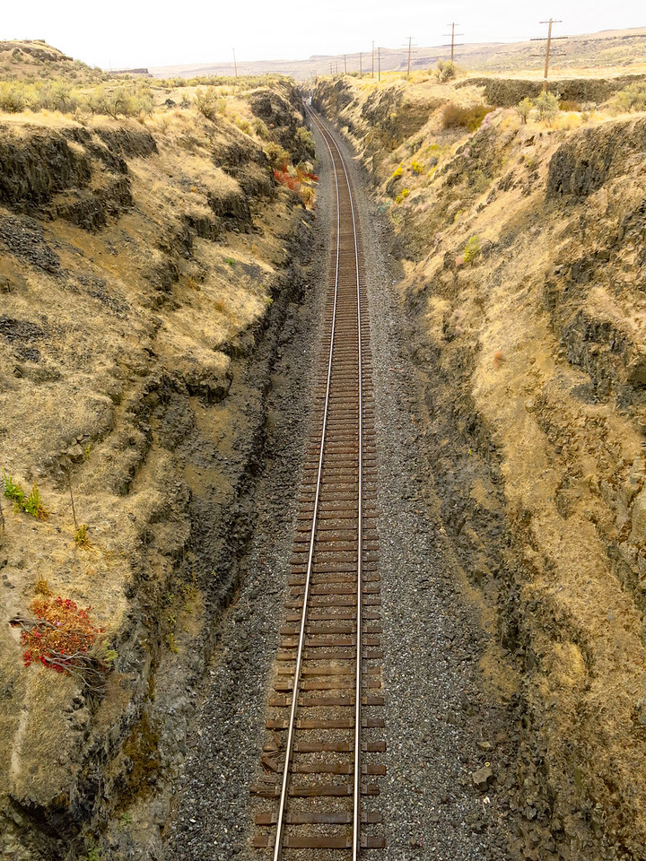 The road to Palouse Falls crosses a cut above a rail line just before entering the state park.  This view is looking north from the car bridge.
