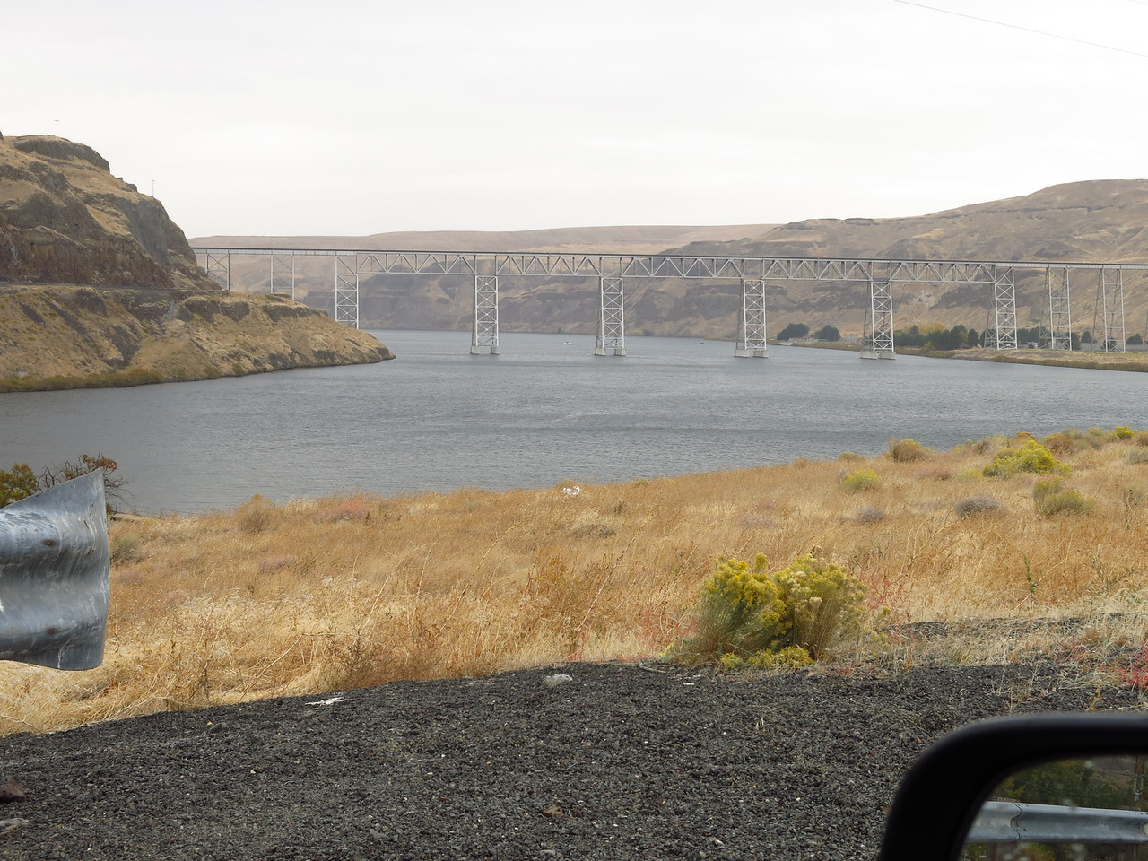 The railroad bridge at Lyons Ferry, as seen from the south-side approach to the highway bridge over the Snake RIver  The marina is in the cove on the left.