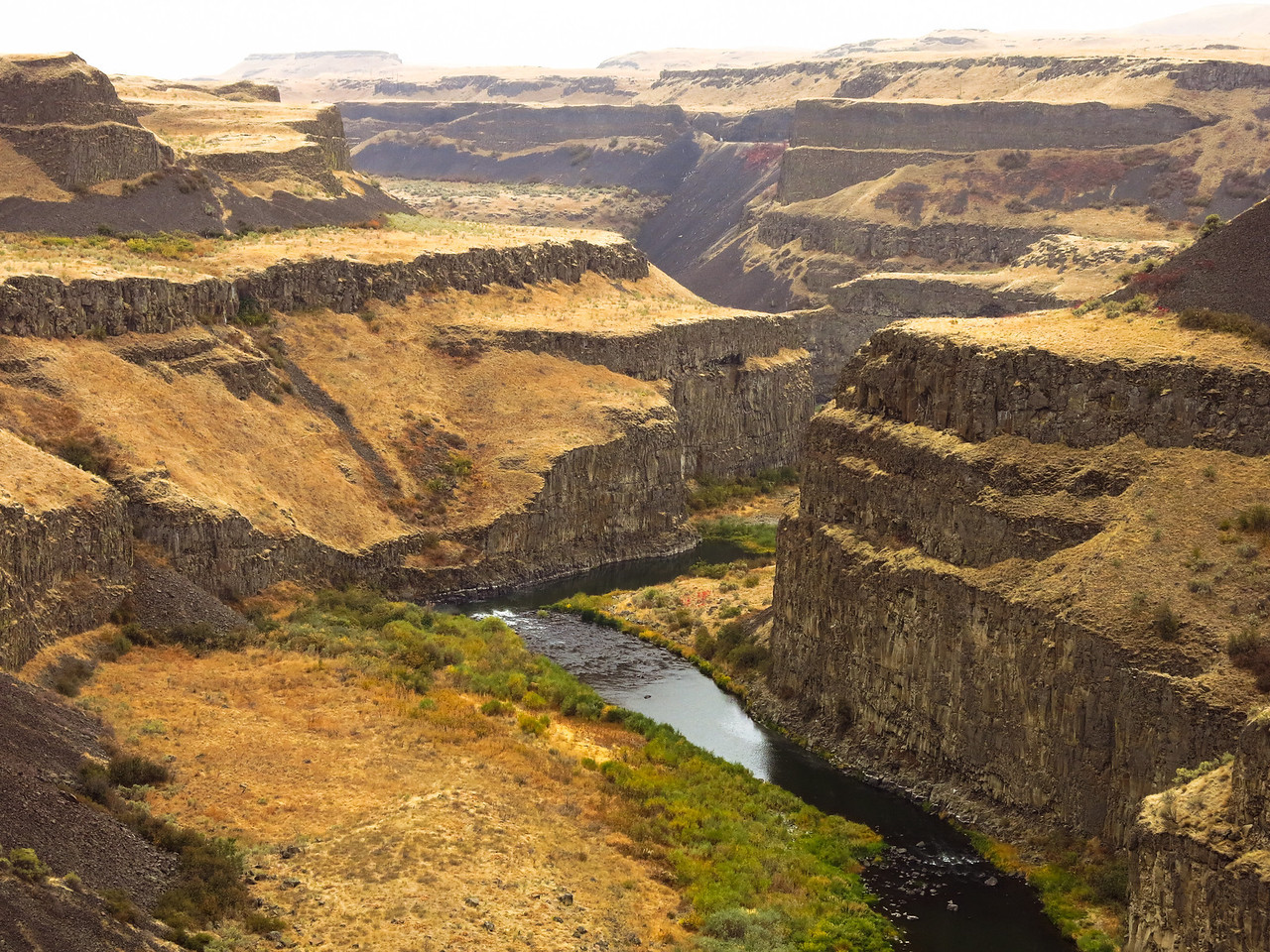 This is a downstream view of the Palouse RIver below Palouse Falls.  The Palouse RIvers empties into the Snake at Lyons Ferry.  The Snake RIver flows west from here and, in about 120 miles from Lyons Ferry, it reaches a confluence with the mighty Columbia River at Pasco, which is one of the Tri-Cities in Washington state.