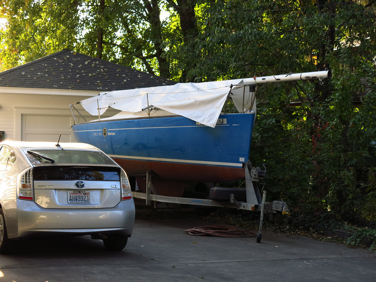 The sailboat on the trailer is a Beneteau First 210.  I used to own one.   I was surprised to see a sailboat in Walla Walla, Washington, which sits a long way from any large body of water.   I wonder where the owner sails it?  Maybe on the Snake River at Lyons Ferry.