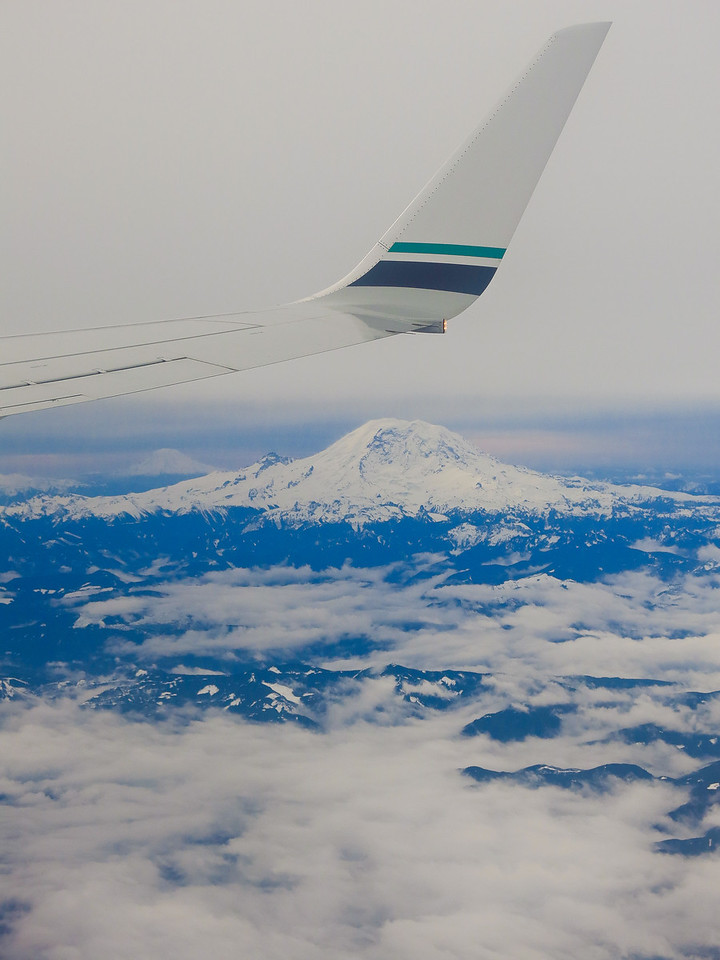It was completely overcast when we took off from Seatac Airport in Seattle.  We were surprised to find that Mount Rainier (and Mount Adams in the distance) were well above the low-lying clouds.