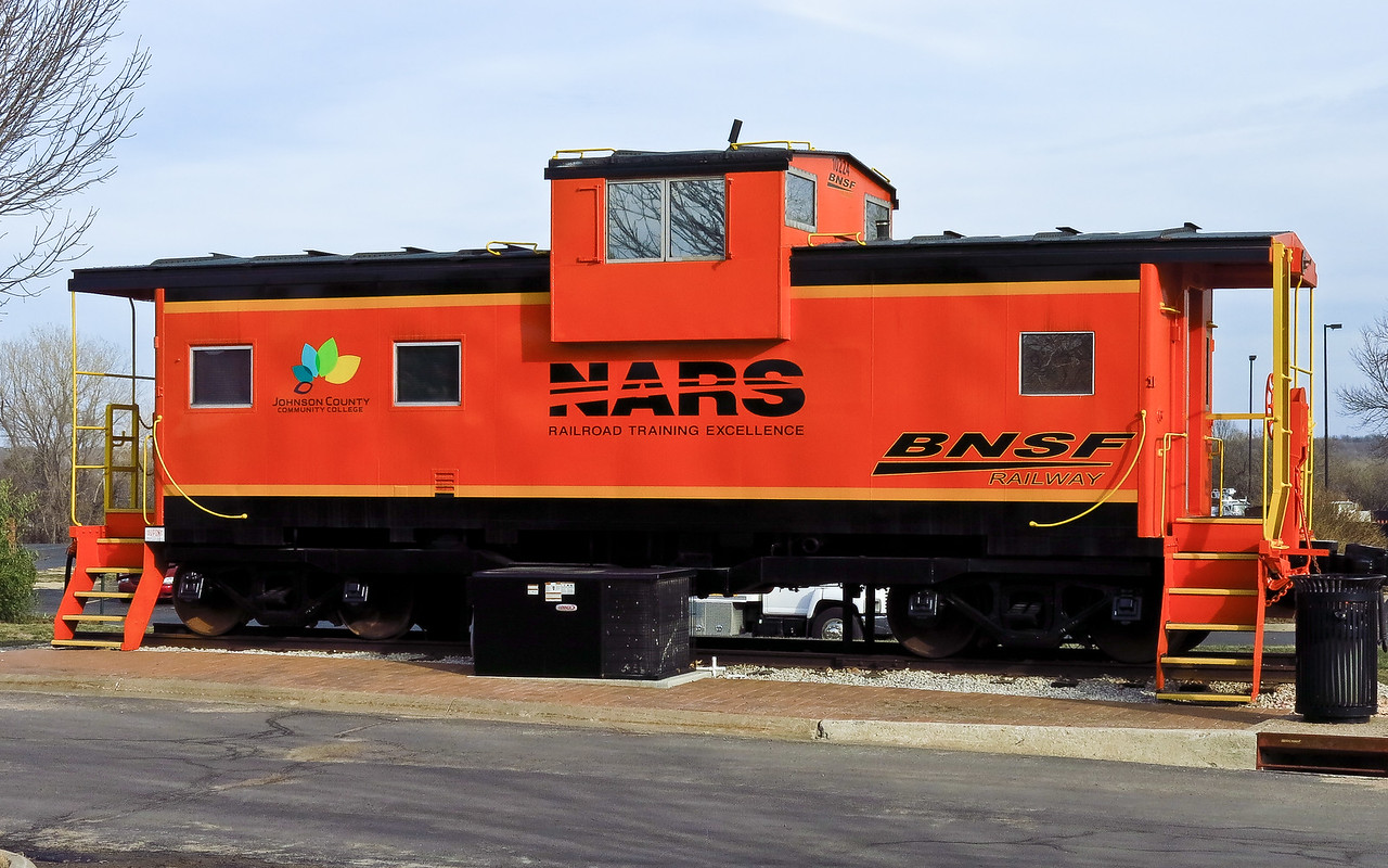 The National Academy of Railroad Sciences (NARS) is jointly sponsored by Johnson County Community College (JCCC) and BNSF Railway.  This caboose sits on the JCCC campus.