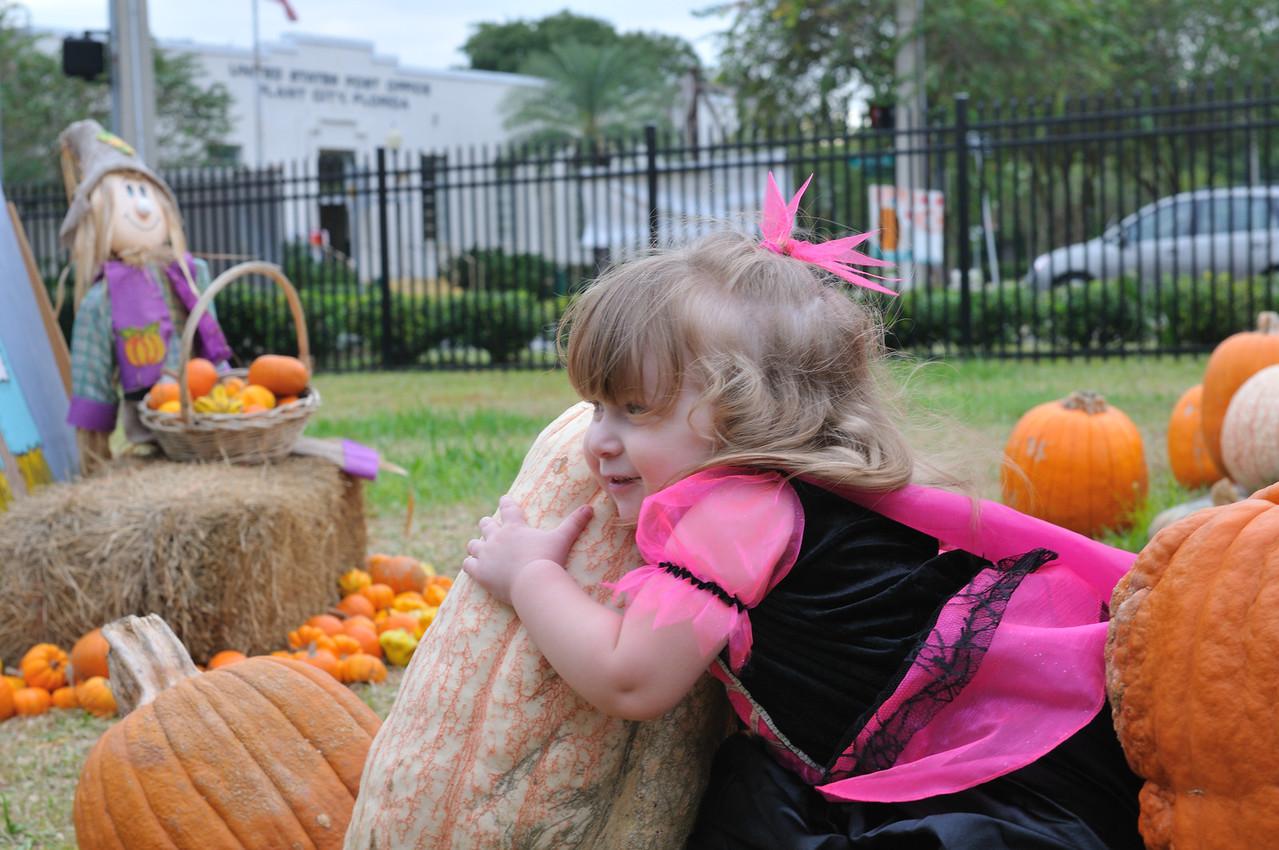 Hugging another pumpkin