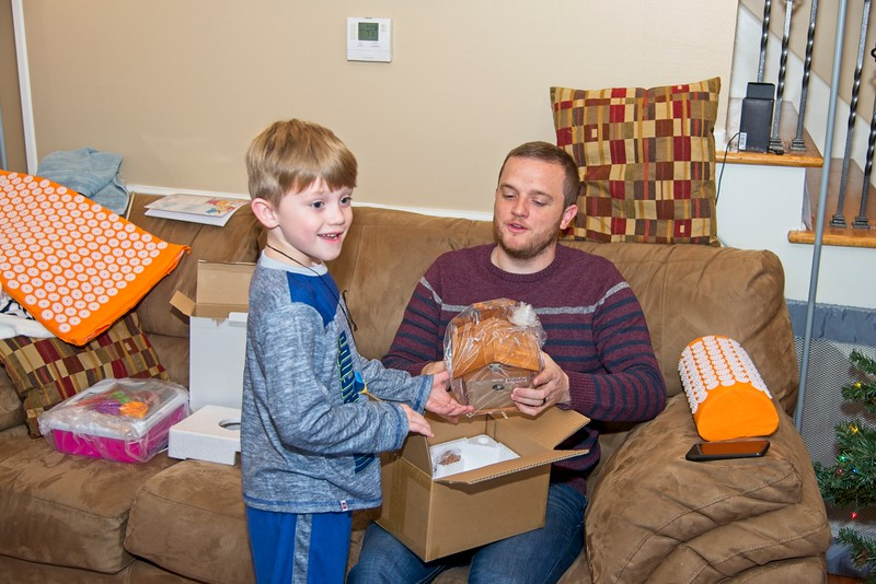 Kyson and Cory with the Cuckoo Clock Kyson got for Christmas