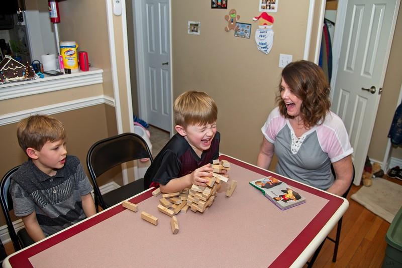 Mimi, Wil and Kyson playing Jenga