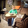 Kyson trying out the guitar