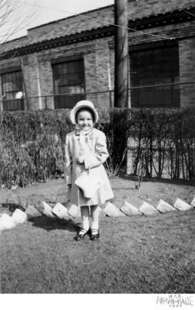 March 25, 1951 1226 Ohio Avenue, Trenton, NJ Easter Sunday, Loretta Kusek. Taken in the back yard of the Kusek house located on Ohio Avenue. The factory in the backgound is Heinamen's Electric Company.
