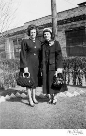 March 25, 1951 1226 Ohio Avenue, Trenton, NJ Catherine (Krulikowski) Kusek with sister, Lottie (Krulikowski) Szymanski. Taken in the back yard of the Kusek house located on Ohio Avenue. The factory in the backgound is Heinamen's Electric Company.
