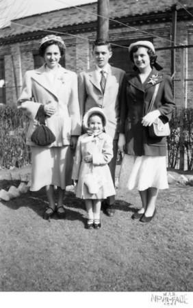 March 25, 1951 1226 Ohio Avenue, Trenton, NJ Sally (Kusek) Hurly, John Joseph Szymanski, Jr., Dorothy (Szymanski) Burtson and Loretta Kusek in foreground. Taken in the back yard of the Kusek house located on Ohio Avenue. The factory in the backgound is Heinamen's Electric Company.